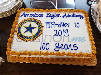 A cake is decorated to celebrate the 100th year anniversary of the American Legion Auxiliary. The event took place at Post 12 in Tyler on Sunday afternoon. (Jessica T. Payne/Tyler Morning Telegraph)