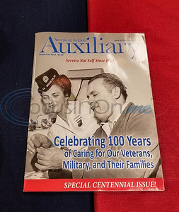 An American Legion Auxiliary magazine celebrating 100 years sits on a table at a reception for the anniversary. The event took place at Post 12 in Tyler on Sunday afternoon. (Jessica T. Payne/Tyler Morning Telegraph)