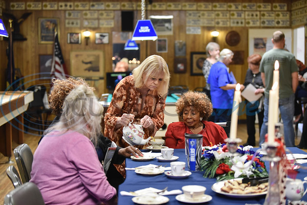 Rene' McQuillin pours tea for guests at American Legion Auxiliary, Post 12 in Tyler to celebrate the 100th year of the organization on Sunday. (Jessica T. Payne/Tyler Morning Telegraph)