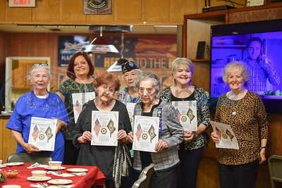 Members of the American Legion Auxiliary smile for a photo while celebrating the 100th year of the organization on Sunday where they received a Continuous Member Certificate. (Jessica T. Payne/Tyler Morning Telegraph)