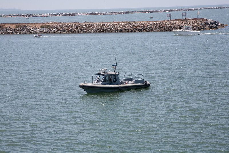 Navy patrol boats spent the day zipping back and forth like border collies keeping civilian boats a safe distance from the ship