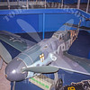 """Messerschmitt Bf. 109G-6<br /> <br /> The world became aware of the Messerschmitt Bf. 109 during the Battle of Britain, and it is to this day Germany's best known aircraft. Its success lay in its maneuverability and its accurate and stable handling. Throughout World War II, new models were developed; the Bf. 109G-6 """"Gustav"""" was among the best.  The first G-6s were delivered to fighter units in 1942 and saw extensive service on the Eastern Front.<br /> <br /> This Bf. 109G-6 is shown in the markings of a fighter of the 7th Squadron, 3rd Group, 27th Wing, which operated over the Eastern Mediterranean."""