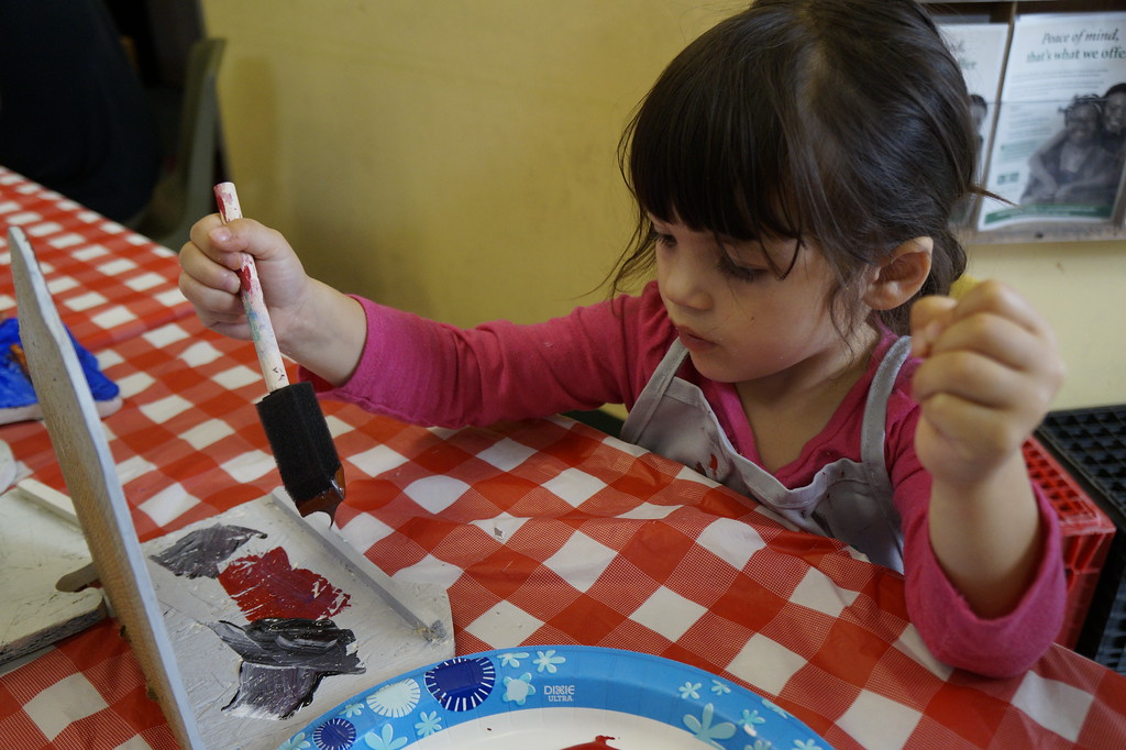 . Children and families paint bird feeders with Mill City Grows and Making Art with Artists on Saturday, October 7, 2017. The feeders will be hung up at Eagle Park and Hampshire Street Community Gardens in the spring.SUN/KATIE DURKIN