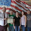 David Ginisi, on left, the North Central Chamber of Commerce membership services associate gives the team from the new Mill City Pub in Fitchburg a citation. From left with Ginisi is Lawrence Lagoy, owner Jess Lagoy, Kelly Wolski and Chris Cordio.