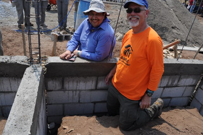2013 05-04 Luis Samayoa, ED of Guatemala HFH and Clive Rainey. Senora said he wanted to put the stone in the 50,001st house because he knew Millard would want to encourage them to move forward with the next 50,000 houses.