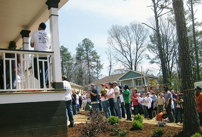 View of crowd gathered for dedication of Gibbens' new home.