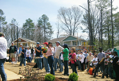 View of crowd gathered for dedication of Gibbens' home.