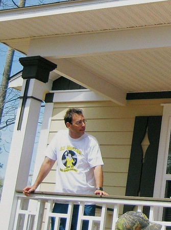 Clark Howard on Gibbens porch ready for house dedication.