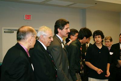 L-R: LeRoy Troyer, Edgar Stoesz (both former HFHI board members), Chris Fuller, Ben & Joshua Fuller
