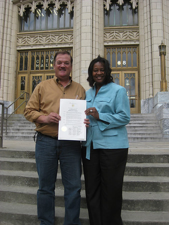 09 04-20 Chair of Greater Atlanta Fuller Center Mark Galey with Dorothea Norman showing Resolution presented by Atlanta City Council