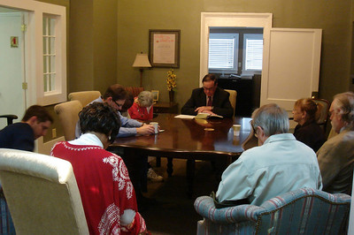 09 02-05 Prayer during devotions period at Fuller Center headquarters in Americus, Ga. led by Judge George Peagler. klb