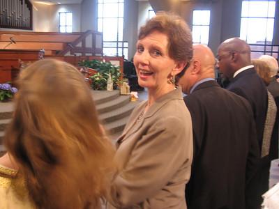 Linda Fuller greets family friend, Fabricio Aires Silva, a grad student from Brazil. Fabricio