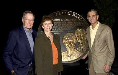 "2001 - President Bush with Linda and Millard Fuller at unveiling of Points of Light ""Extra Mile"" bronze medallion. In 2005, the medallion was placed in Washington, DC as part of the ""Extra Mile Pathway"" along with founders of other organizations and movements."