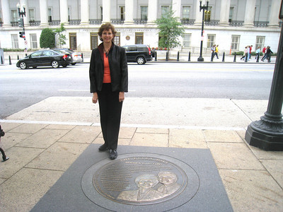 10 10-01 Linda Fuller at Points of Light Extra Mile Pathway sidewalk medallion.