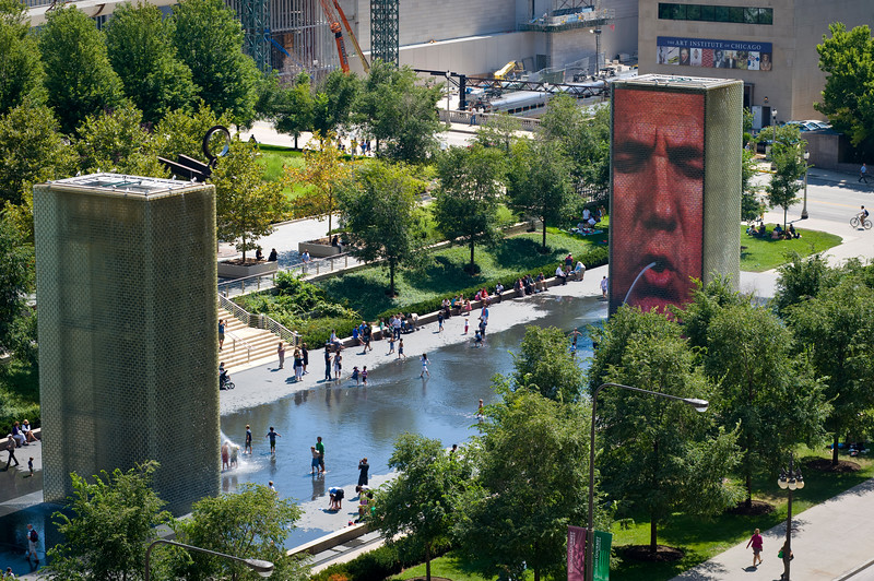 Crown fountains in Millennium Park are surrounded by nature