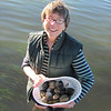 Sonya holding the clams.