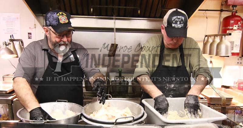 VFW Commander Mick Cohagen and Larry Beckner bread fresh cod fish for their Friday Lenten fish fry in Millstadt.