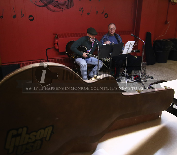 Randy Halleran and Rob Maller of the Boys II Old duo play music at the VFW in MIllstadt .