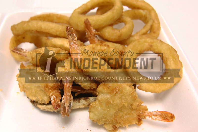 Shrimp with onion rings fried to a golden crunch . Cod and walleye is also available.