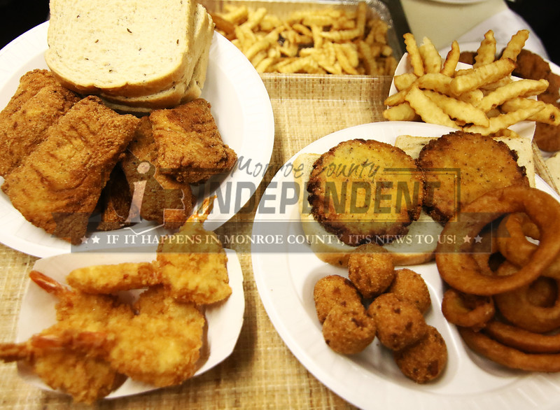 Cod fish,shrimp and salmon patties along with french fried and onion rings and hish puppies are available at the Millstadt Sportsman Club Lenten fish fry.