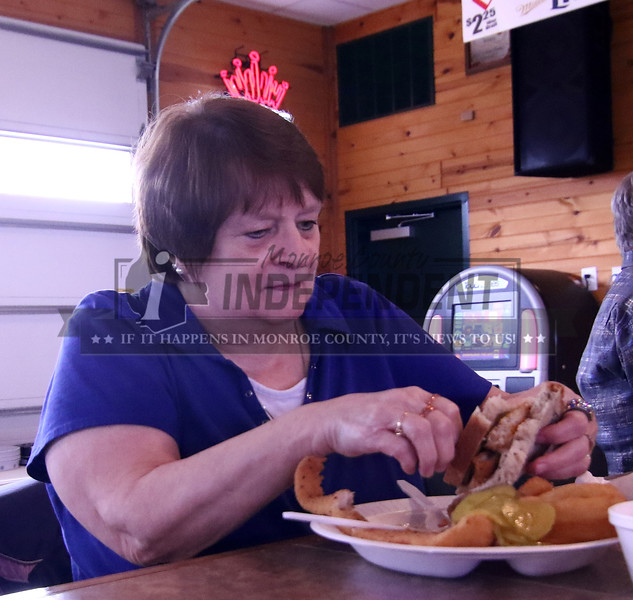 Elaine Koehler of Waterloo fixes up her fish sandwhich and prepares to dig in.