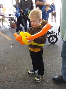 orange balloon sword and yellow belt
