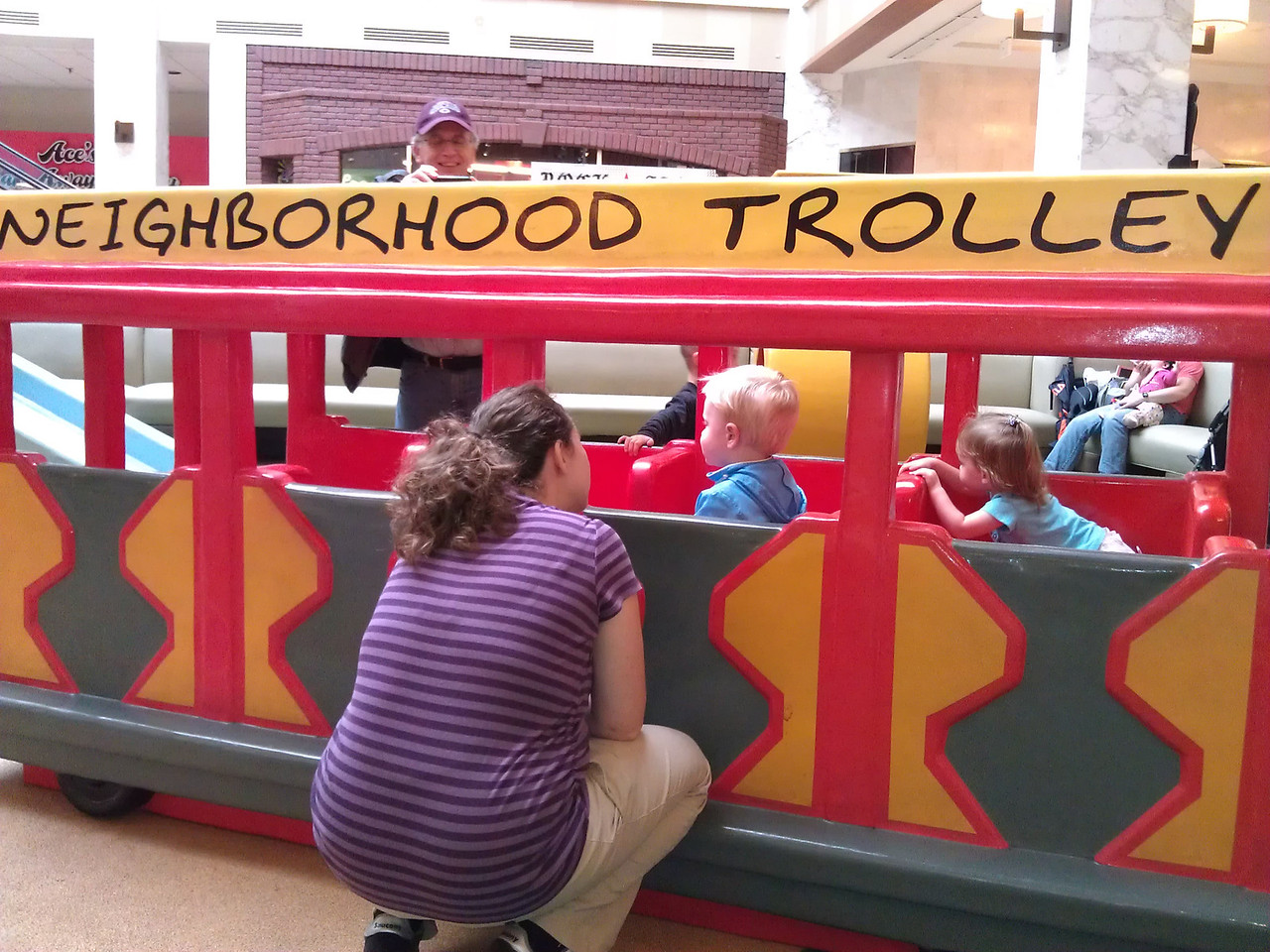riding the trolley with Mommy nearby