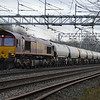 66124 heads 6H50 Willesden - Tunstead empty cement tanks past Bradwell, MK on 18th Jan 2014