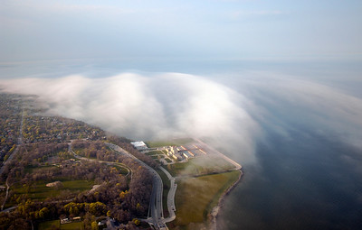 Fog envelopes the Milwaukee Water Works Linnwood treatment plant on the shore of Lake Michigan.