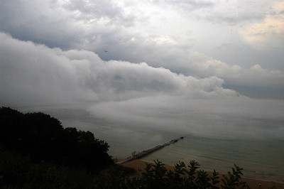 Fog rolls in with cooler air just off shore of Atwater Park in Shorewood, WI.