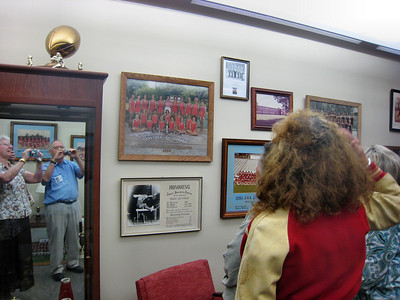 Touring MHS Buildings at Open House for Alumni - Yes, that is my(Reagan Frazier) reflection in the mirrow along with Phyllis Roberts Smith -- Oree Hoefeld Robison facing the photos of Swimming Championship Team.