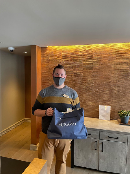 Front-desk manager Ryan gives each guest a complimentary bag or knapsack filled with goodies.