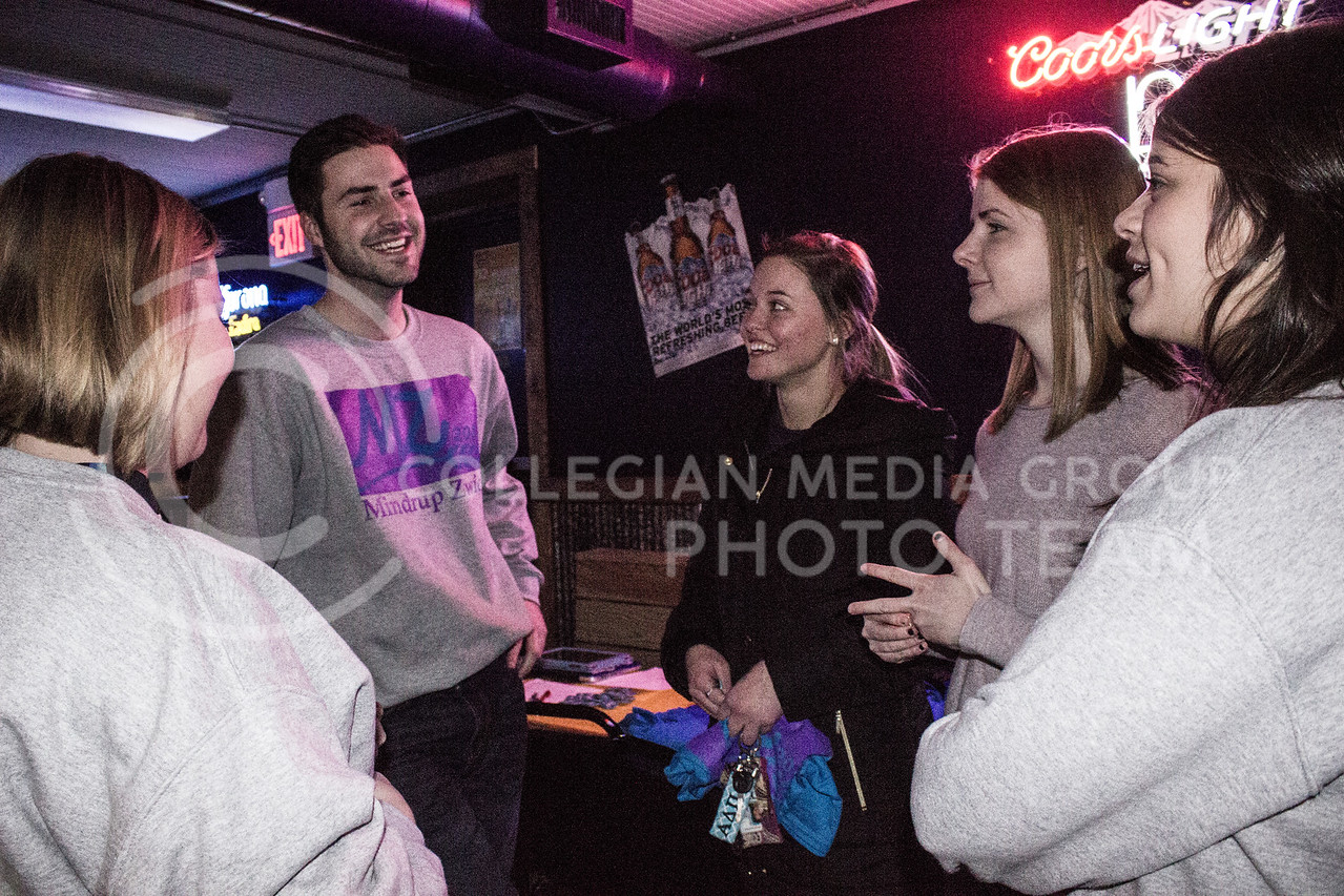 Sophomore in Biology and SGA canidate Matt Mindrup talks to a group of friends at the launch party at Fuzzy's Taco Shop on Feb. 03, 2017. (Kelly Pham | The Collegian)