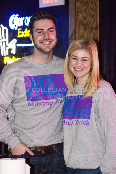 SGA canidates Matt Mindrup and Emily Zwick pose for a snapshot at their launch party at Fuzzy's Taco Shop on Feb. 03, 2017. (Kelly Pham | The Collegian)