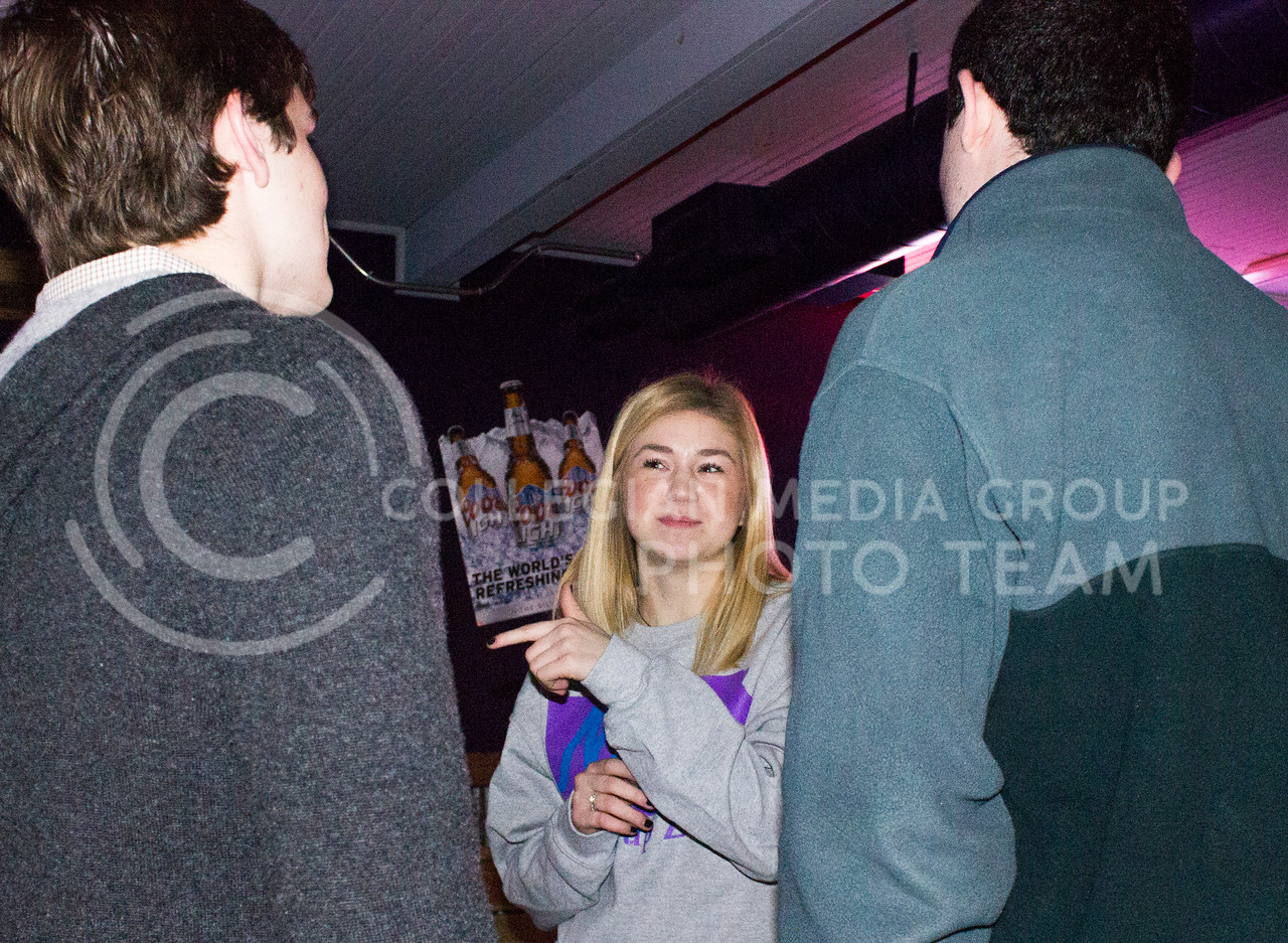 SGA canidate studying agricultural economincs Emily Zwick talks to sophmores both studying accounting Conner Swenson and Andrew Stewart at the launch party at Fuzzy's on Feb. 03, 2017. (Kelly Pham | The Collegian)