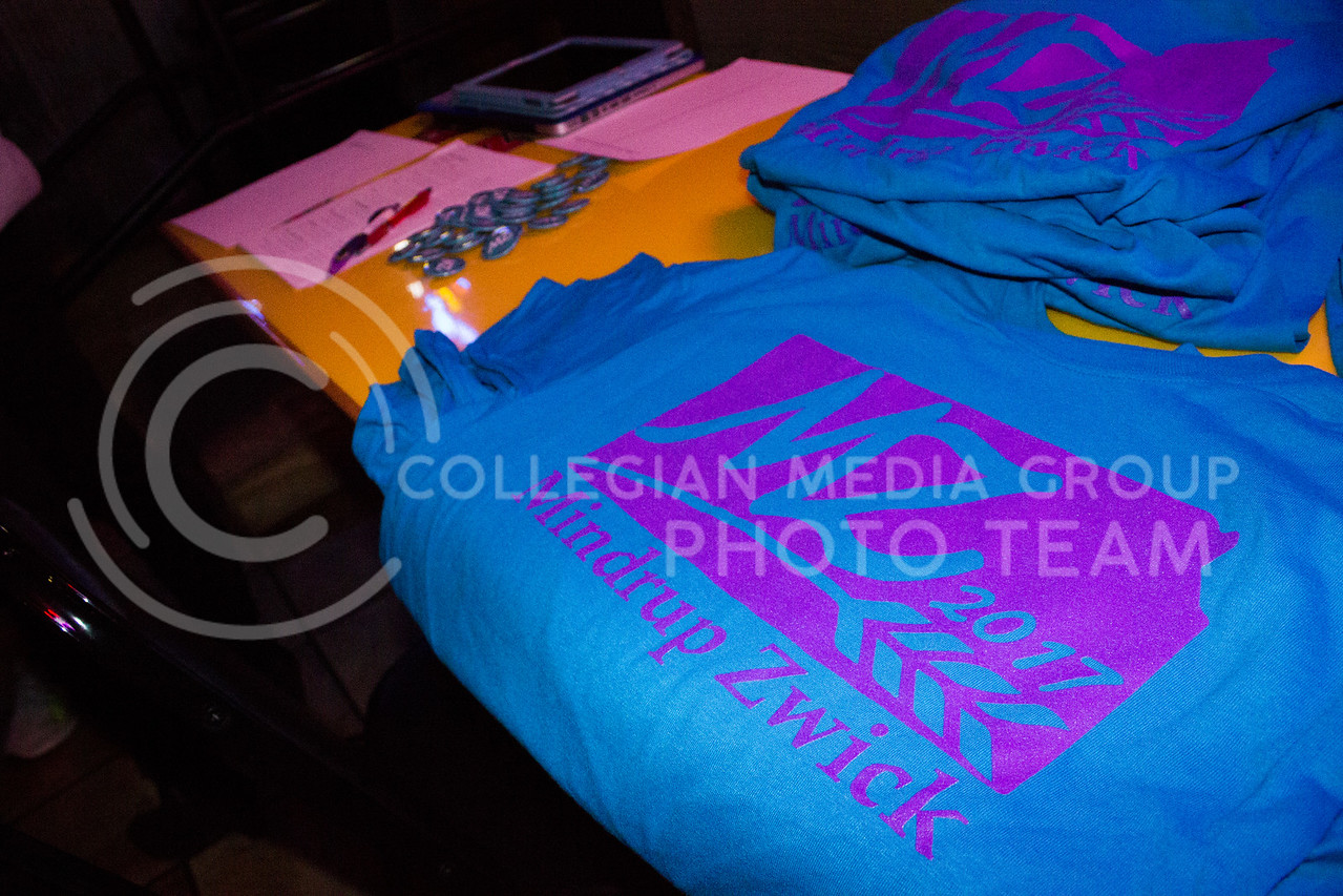 Layout of t-shirts and buttons to support SGA canidates Matt Mindrup and Emily Zwick at the launch party at Fuzzy's on Feb. 03, 2017. (Kelly Pham | The Collegian)