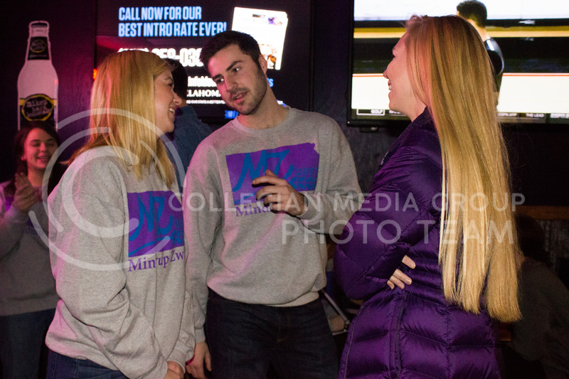 Sophomore SGA canidates Emily Zwick (Agricultural Economics) and Matt Mindrup (Biology) conversate with sophomore in industrial engineering Laura Bergkamp at the launch party at Fuzzy's on Feb. 03, 2017. (Kelly Pham | The Collegian)