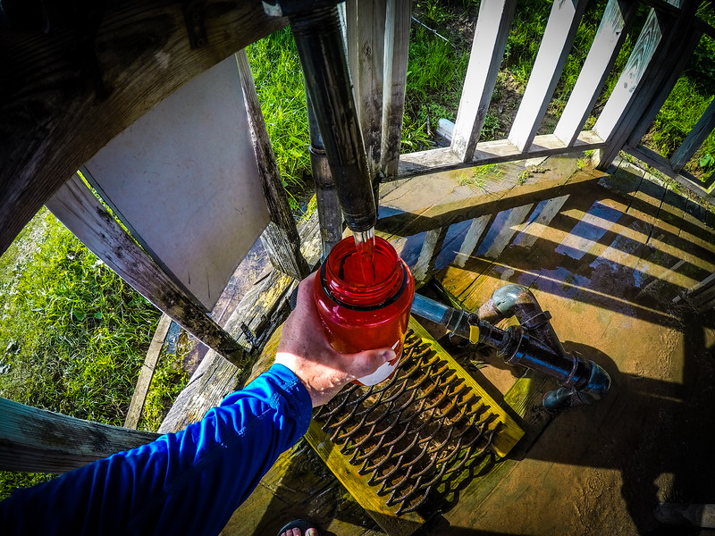 Filling up with water from the Artesian Well in Cornucopia wayside stop