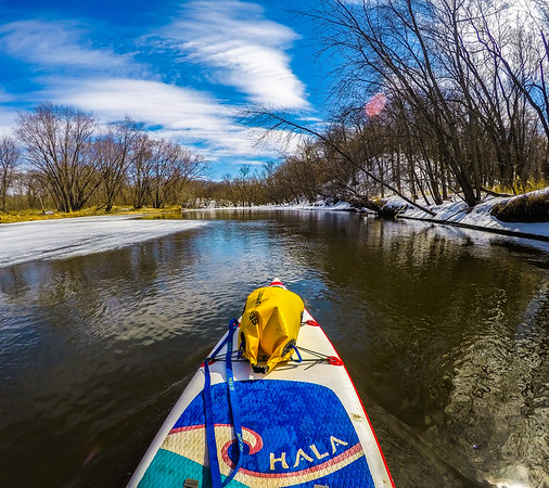 Sure wherever there is no ice the current is pushing against me. Given that totally makes sense why it is open then. Makes for a great training paddle up the river