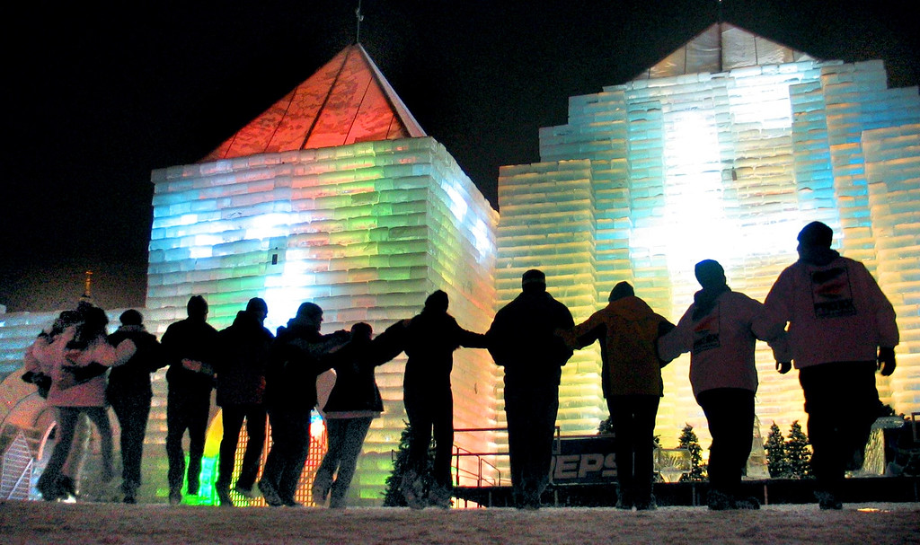 . Visitors to the Winter Carnival ice castle form a dance line as they dance to the music which is part of the sound and light show at the castle on Jan. 26, 2004.  (Pioneer Press File)