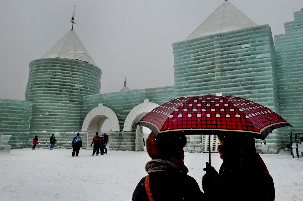 . Japanese tourists, traveling on a tour organized by Global Youth Bureau based out of Tokyo, visit the St. Paul Winter Carnival ice castle on Jan. 26, 2004. (Pioneer Press File)