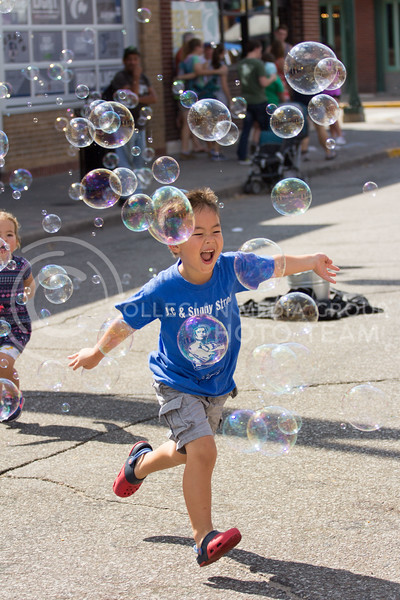 Children run around chasing bubbles during the Mini Maker Fair on 23 Sept. 2017 (Alex Shaw | Collegian Media Group)