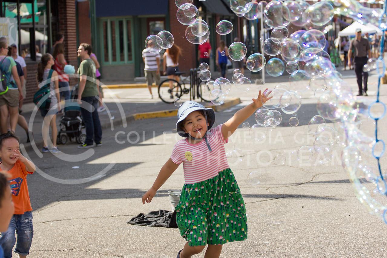Children run around chasing bubbles during the Mini Maker Fair on 23 Sept. 2017 (Alex Shaw   Collegian Media Group)