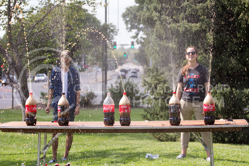 Fair coordinators Leah Hyman, and Alan Gamer drop mentos into different bottles of soda at the Mini Maker Fair on 23 Sept 2017 (Alex Shaw| Collegian Media Group)
