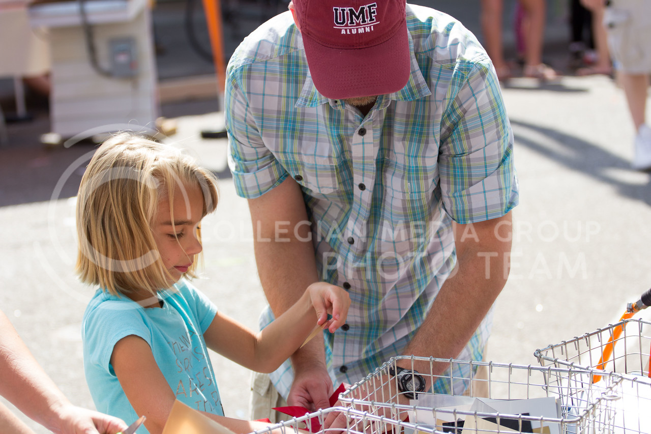 Nate Grindel and his daughter Eleanor Grindel pick out decals to make their own t-shirt at the Mini Maker Fair on 23 Sept. 2017 (Alex Shaw Collegian Media Group)
