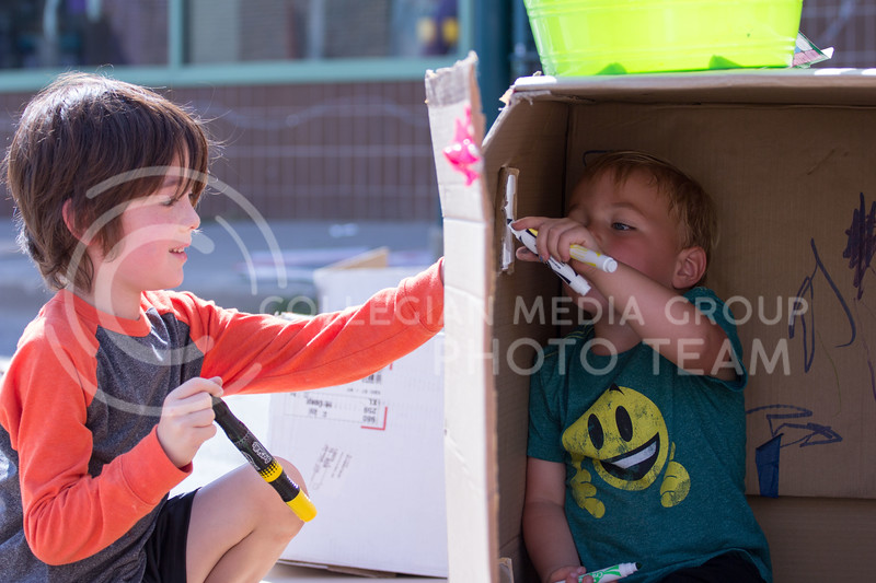 Griffin Stone and Christopher Mcnara play in the cardboard boxes that remained after the Box hattan event held at the Mini Maker Fair on 23 Sept. 2017 (Alex Shaw | Collegian Media Group)