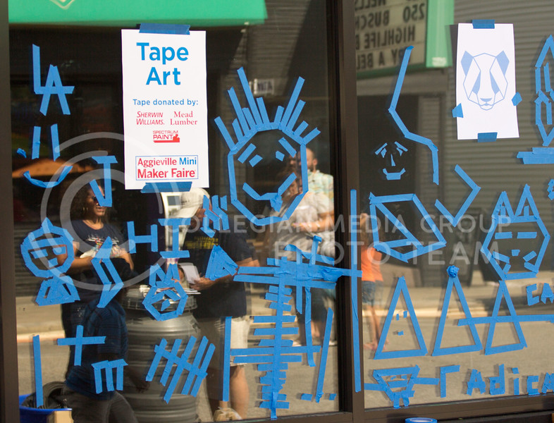 Over the course of the day people came up and made art out of tape on the windows for the 4th annual Mini Maker Fair on 23 Sept. 2017 (Alex Shaw | Collegian Media Group)