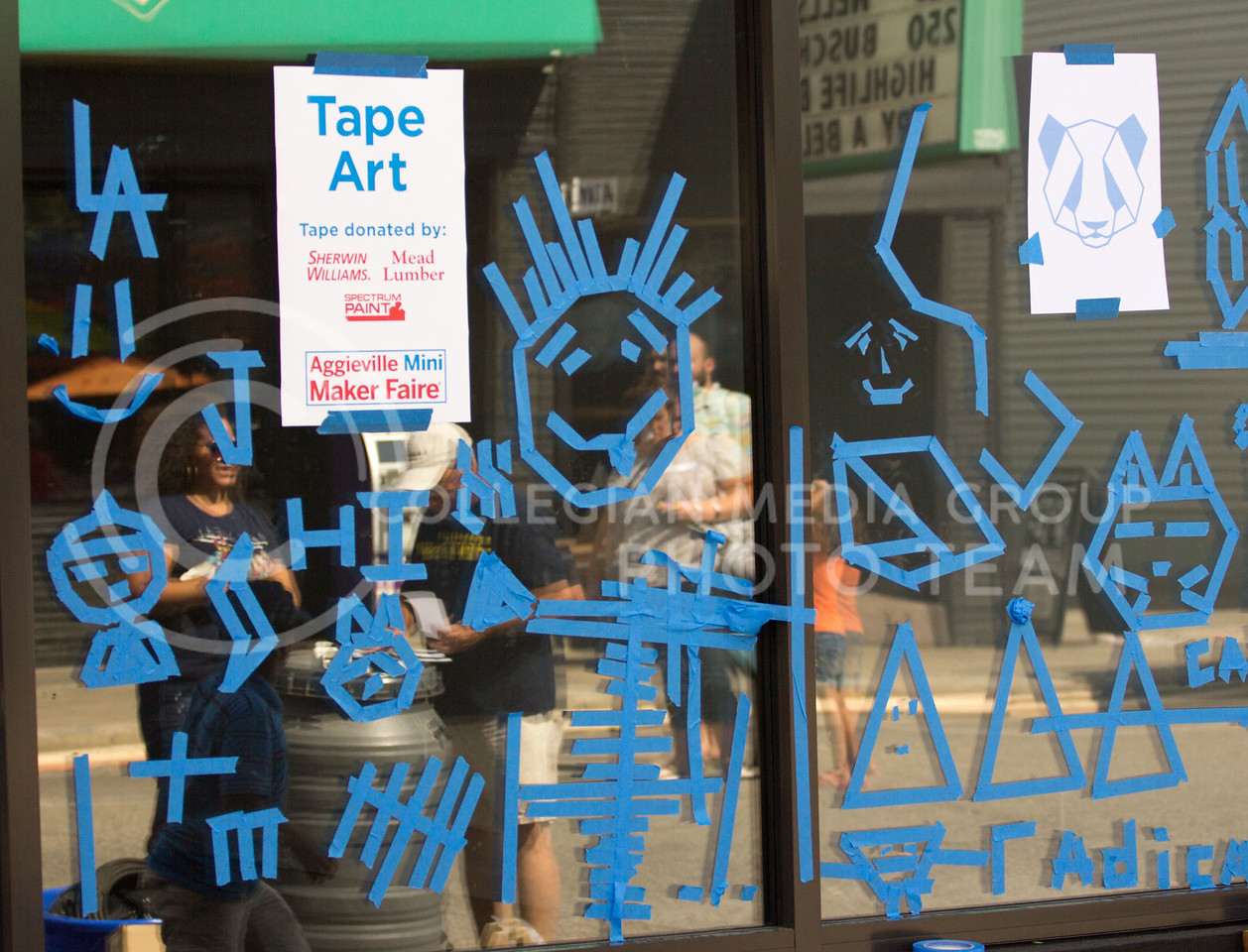 Over the course of the day people came up and made art out of tape on the windows for the 4th annual Mini Maker Fair on 23 Sept. 2017 (Alex Shaw   Collegian Media Group)