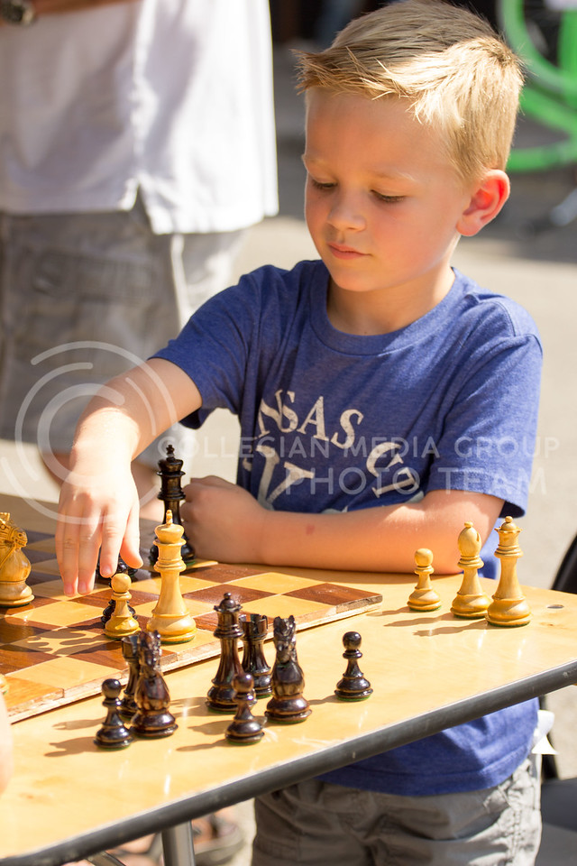 Grant Wilson Plays chess at the KSU Chess Club Tent during the Mini Maker Fair on 23 Sept 2017 (Alex Shaw Collegian Media Group)
