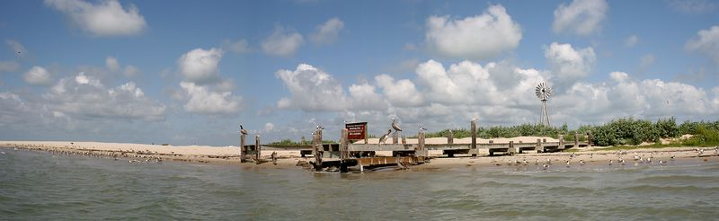 Panoramic view of the dock area at Sundown Island.  The U.S. Army Corps of Engineers filled in areas around the dock and in front of the windmill because of the severe erosion in this area.